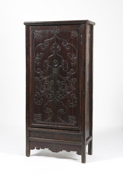Chinese Art. A hard wood wardrobe decorated with archaic motifs China, Qing dyna…