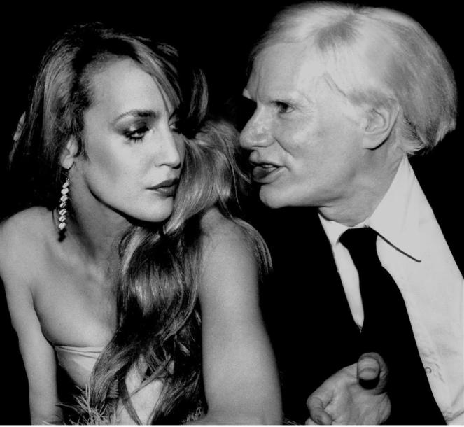JERRY HALL & ANDY WARHOL CONVERSING. By Rose Hartman. Studio 54. 1978. Tirage numérique…