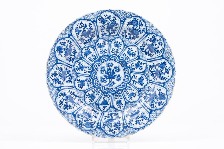 A large scalloped plate Chinese export porcelain  Blue underglaze decoration of …