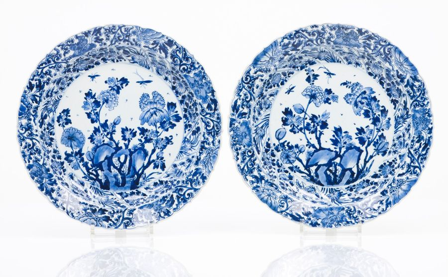 A pair of large scalloped plates Blue underglaze decoration with central composi…