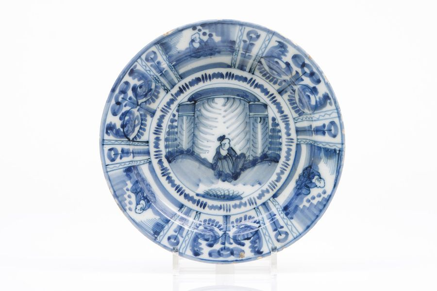 A deep plate Delft faience  Blue Wanli style decoration with chinese figure in t…