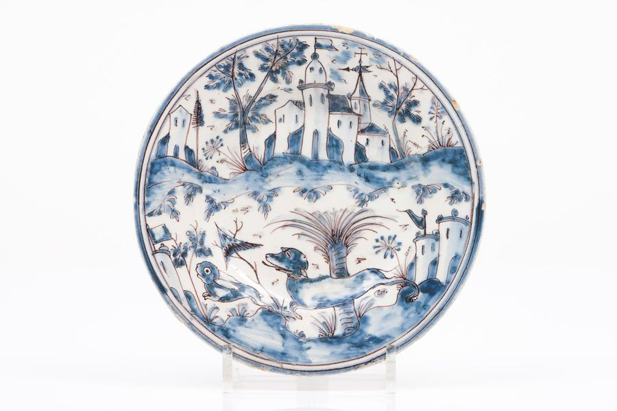 "A plate Portuguese faience  Blue and manganese ""Desenho Miúdo"" decoration with l…"
