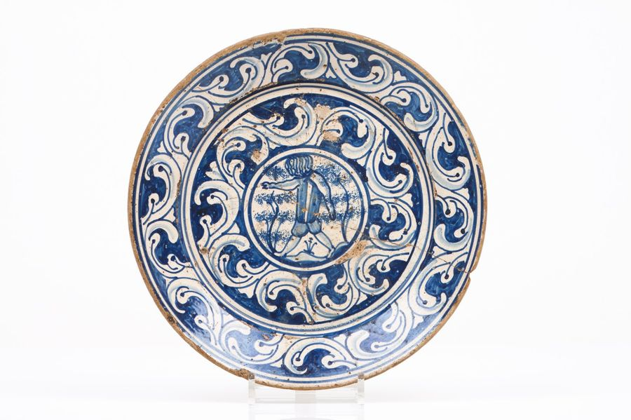 A plate Faience  Blue and manganese decoration with double baroque band and cent…