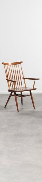 GEORGE NAKASHIMA (1905 - 1990) New Fauteuil Noyer. On y joint une copie de la facture…