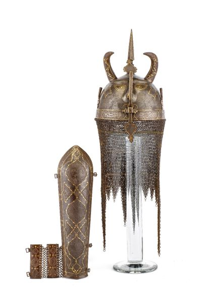 ‡ A PERSIAN HELMET (KULAH KHUD) AND ARM DEFENCE (BAZU BAND), QAJAR, SECOND HALF …