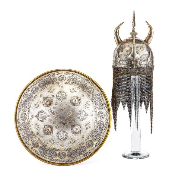 ‡ A PERSIAN HELMET (KULAH KHUD) AND SHIELD (DHAL), QAJAR, SECOND HALF OF THE 19T…