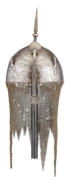 ‡ A PERSIAN HELMET (KULAH KHUD), QAJAR, LATE 19TH CENTURY with etched hemispheri…