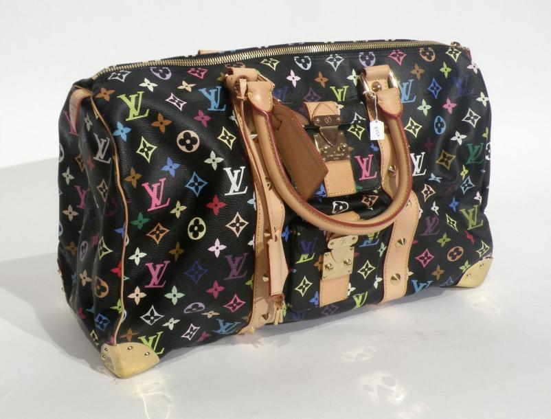 Louis VUITTON. Grand speedy, toile monogram multicolore sur fond noir, ornements…