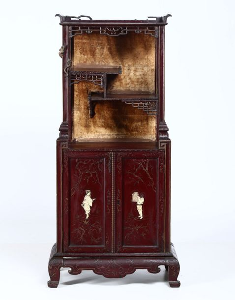 A wooden cabinet, Japan, Meiji period (1868 1912). Two doors, lacquered wood wit…