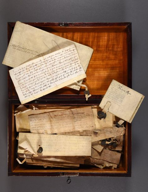 A wooden box with 35 documents and 5 seals. 14th 18th c Various sizes, on vellum…