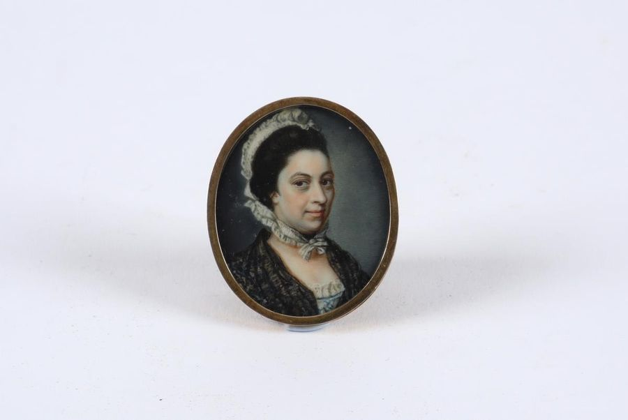 Λ James Scouler (1741 1812) Portrait miniature of a Lady in a white dress, black…