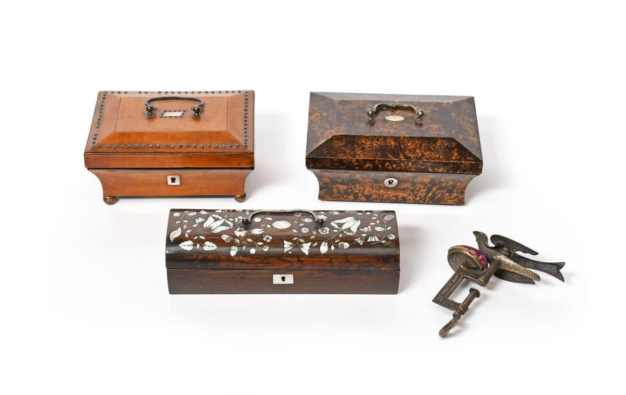 Three sewing boxes 19th century, one with a burr veneer and opening to reveal an…