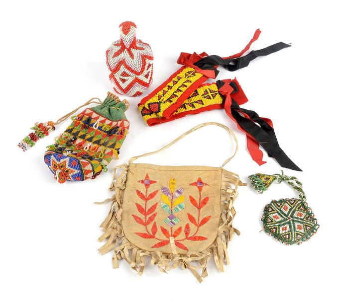 An Eastern Sioux quilled pouch Plains hide with a floral design, 15.5cm high, a …