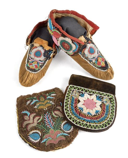 A pair of Maliseet moccasins Northeast hide with coloured glass bead floral inst…