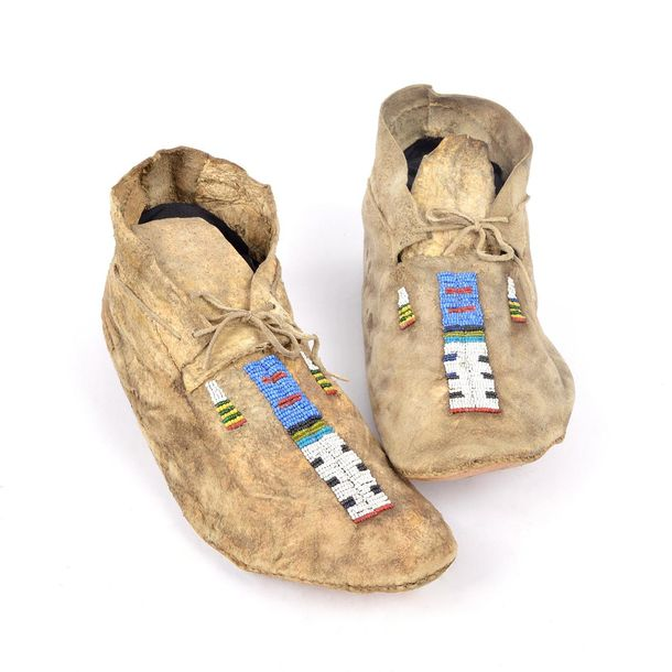 A pair of Arapaho moccasins Plains hide with blue, red, white, green, black, tea…