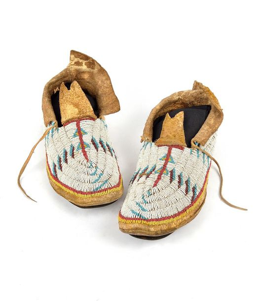 A pair of Lakota moccasins Plains hide with white, red, yellow, blue glass beads…