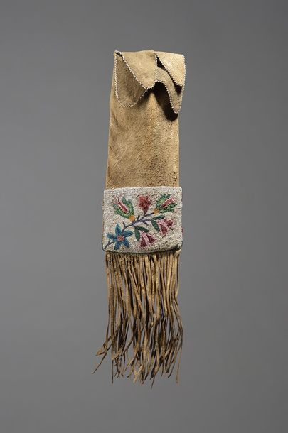 A Chippewa pipe bag Northern Plains hide with two coloured glass beaded floral p…