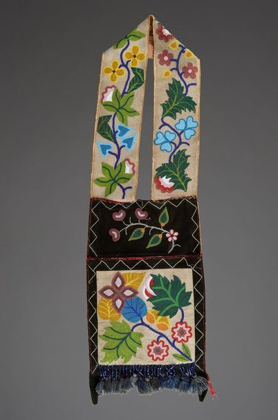 An Ojibwe bandolier bag Northeast velveteen with coloured glass beads of floral …