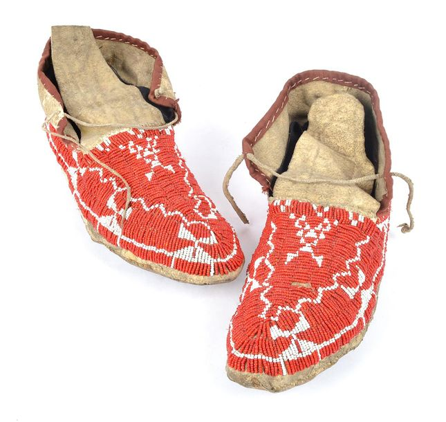 A pair of Lakota moccasins Plains hide with red and white glass bead decoration,…