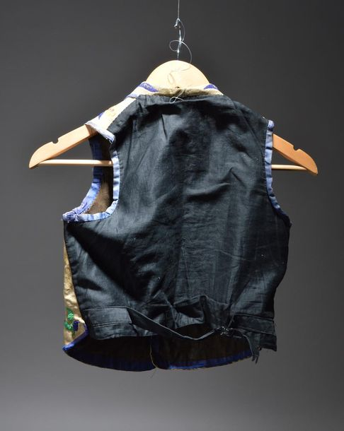 An Eastern Sioux child's beaded vest Plains with buckskin front having lapels an…