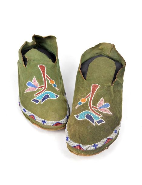 A pair of Kiowa moccasins Plains green stained hide with glass beaded bird on a …