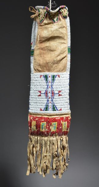A Lakota pipe bag Plains buckskin, coloured glass beads and dyed quill, with dif…