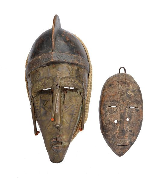 A Dan passport mask Ivory Coast 14.5cm high, and a Marka mask, with sheet brass …