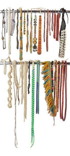 A collection of West African bead necklaces glass, stone, metal, cowrie shells, …