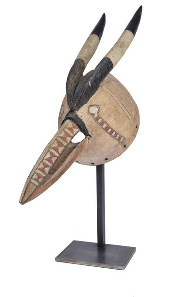 A Mossi mask Burkina Faso modelled as an antelope head with black, white and red…