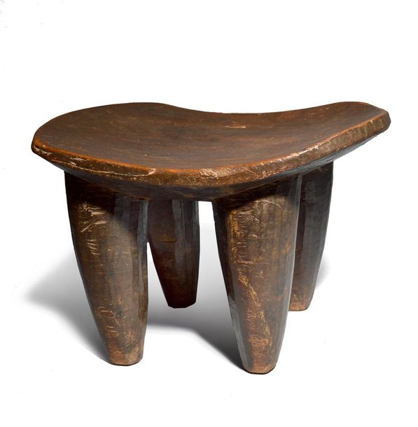 A Senufo stool Ivory Coast with a dished seat and facet tapering legs, 28.5cm hi…