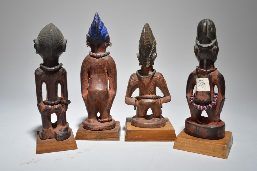 Four Yoruba Ibeji figures Nigeria including two male and two female, one male wi…
