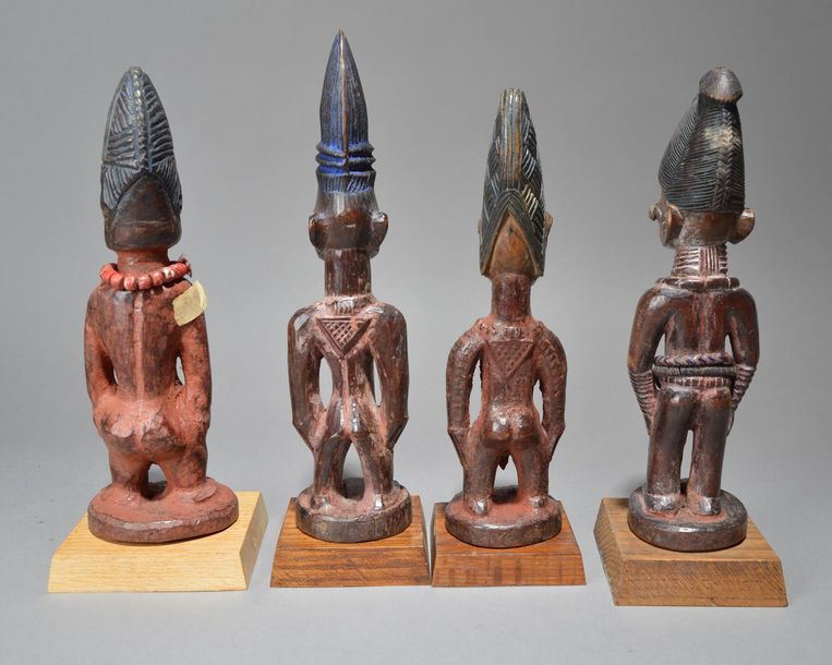 Four Yoruba Ibeji figures Nigeria including two males and two females, two with …