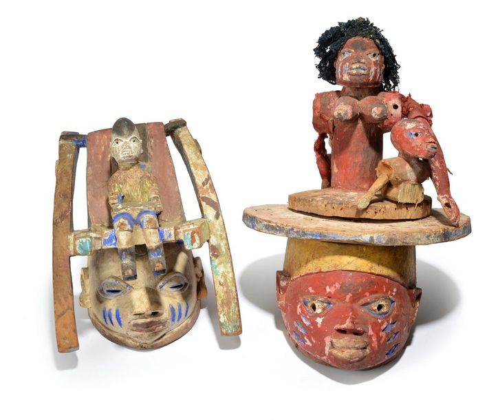 Two Yoruba Gelede masks Nigeria with pigment decoration, one with a figure sitti…
