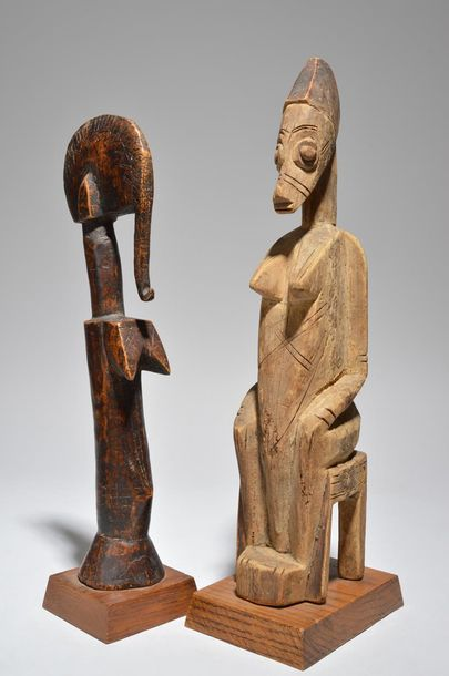 A Mossi doll Burkina Faso with incised decoration, 33cm high, and a seated femal…