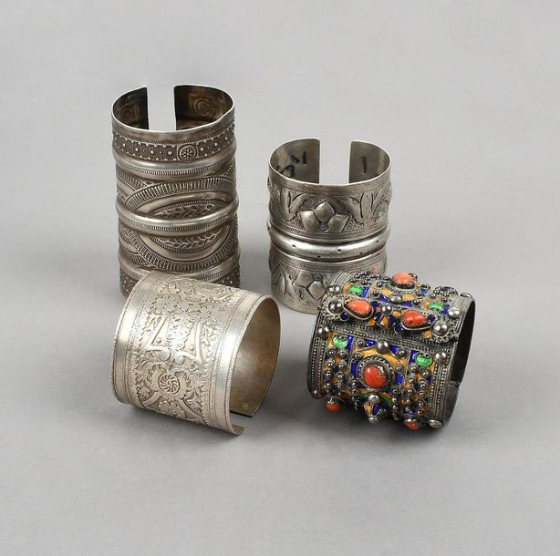 Four North African cuff bracelets silver coloured metal, including Siwa with bir…