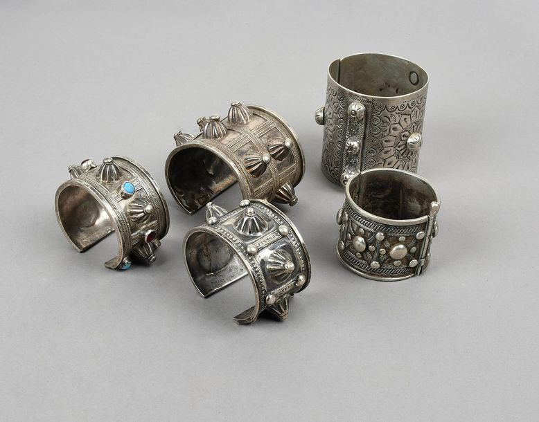 Three Nubian bracelets silver coloured metal, with ribbed dome decoration, one i…