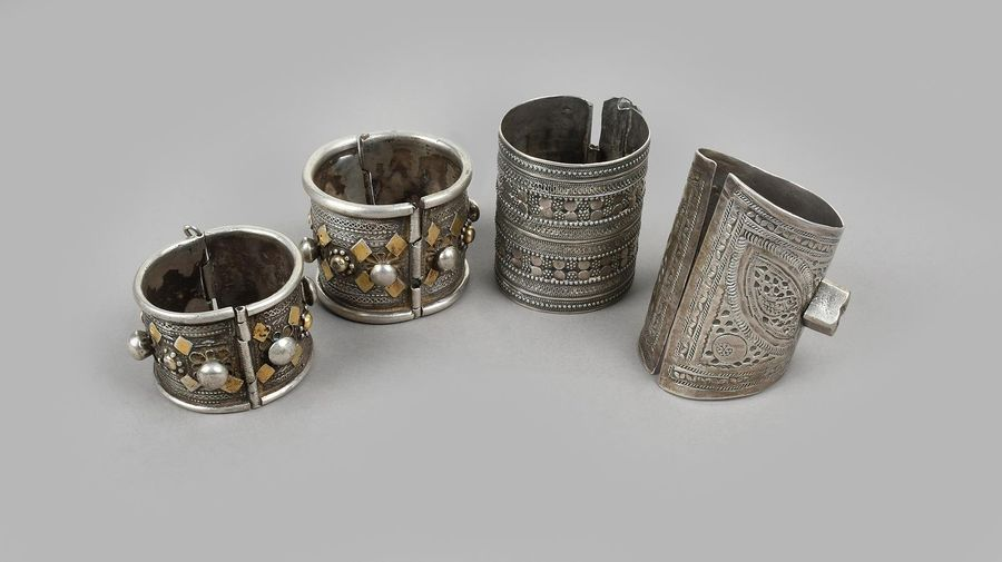 Three Nubian bracelets silver coloured metal, including Libya with engraved deco…