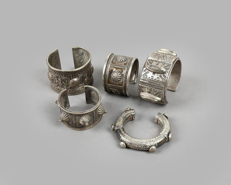 Two Egyptian bracelets silver coloured metal, with oblong and round relief decor…