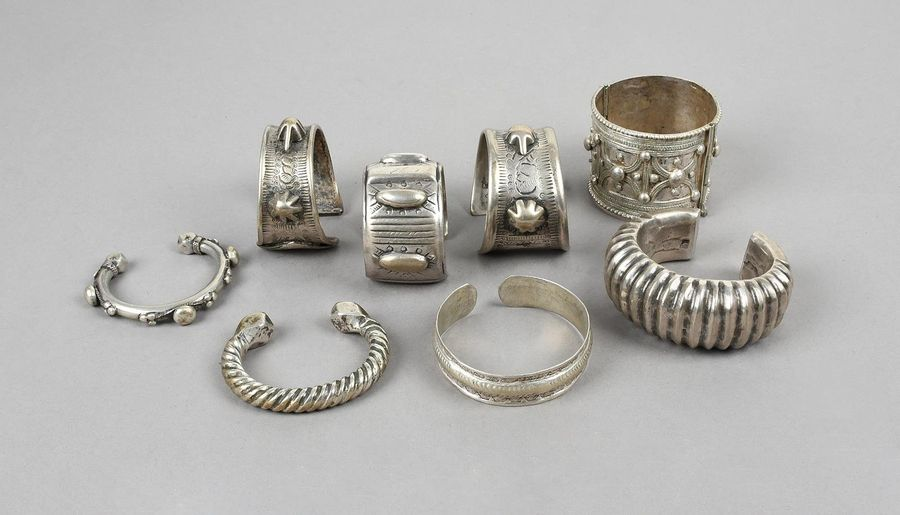 Three Bedouin bracelets silver coloured metal, two with applied tortoises, with …