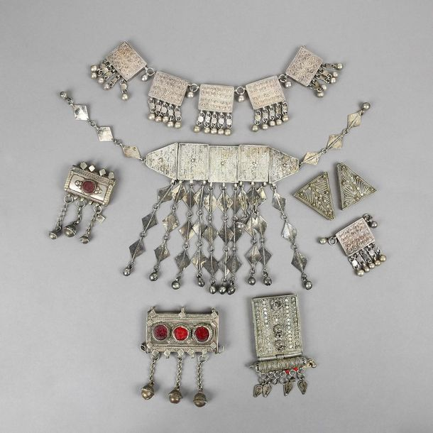 Three Bedouin hirz receptacles silver coloured metal with glass, the widest 8.2c…