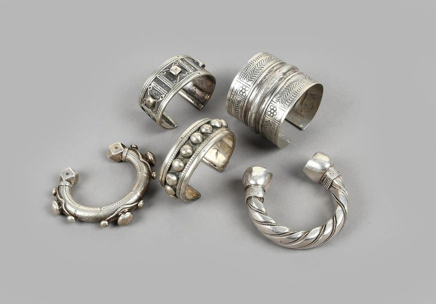 Five bracelets silver coloured metal, including four Egyptian, with hallmarks an…