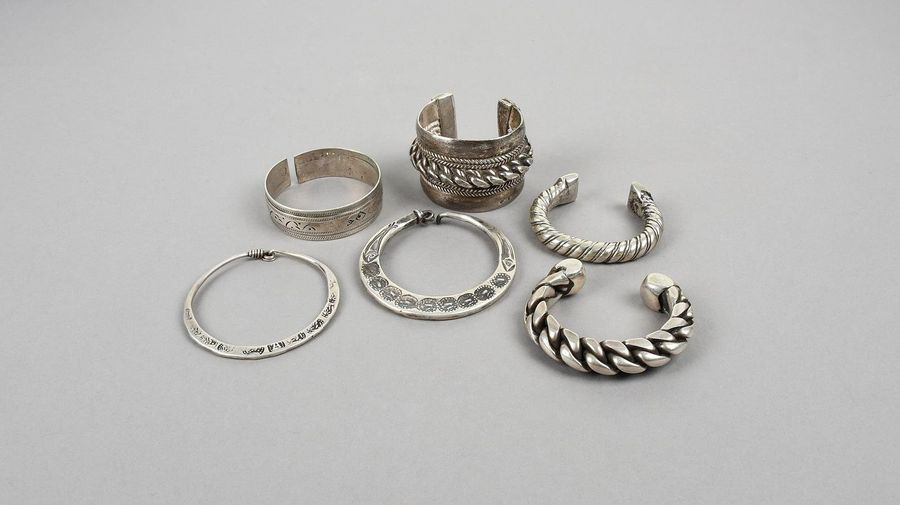 Four Egyptian bracelets silver coloured metal, including Siwa with engraved flyi…