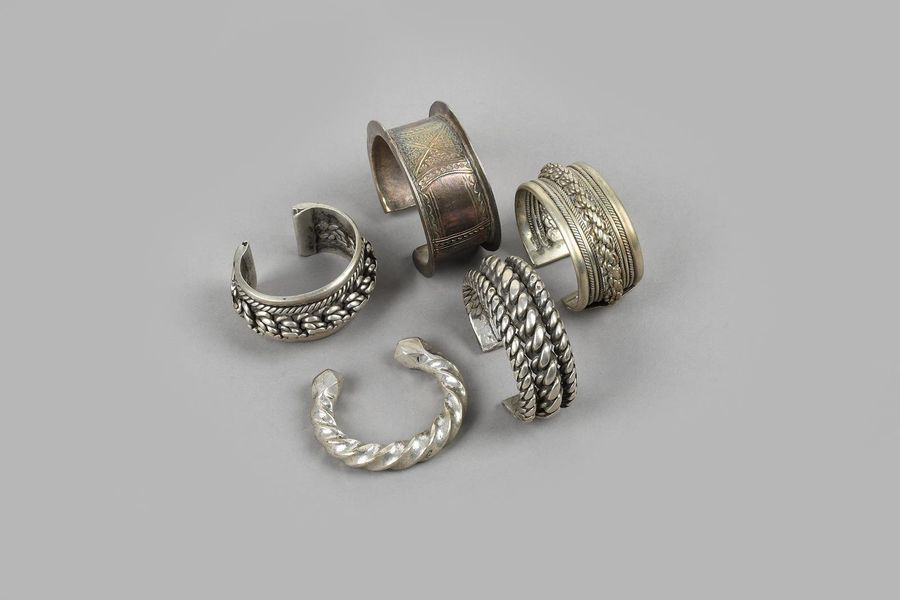 Five Egyptian bracelets silver coloured metal, three with rope twist decoration,…