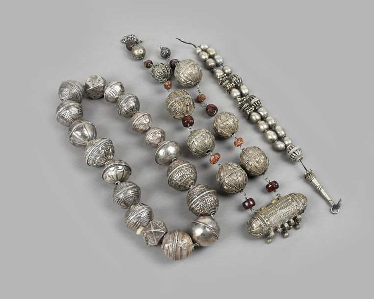 A Yemen hirz necklace silver coloured metal, with large beads, a prayer containe…