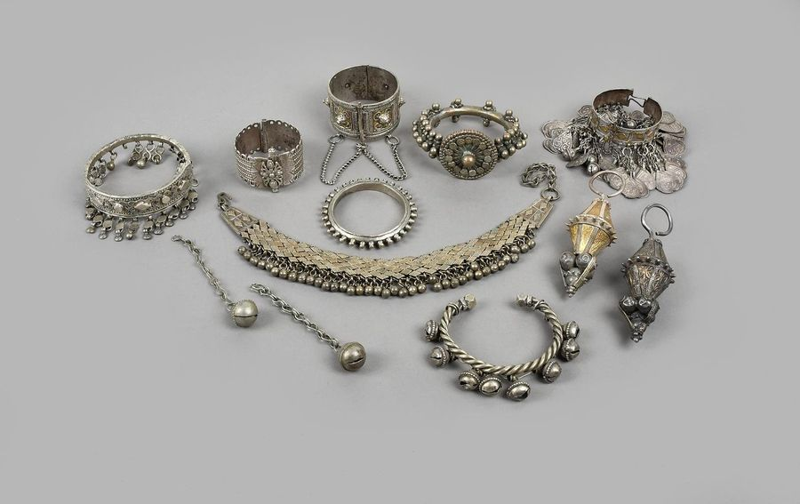 Six Yemen bracelets silver coloured metal, one hung with bells, one hung with he…