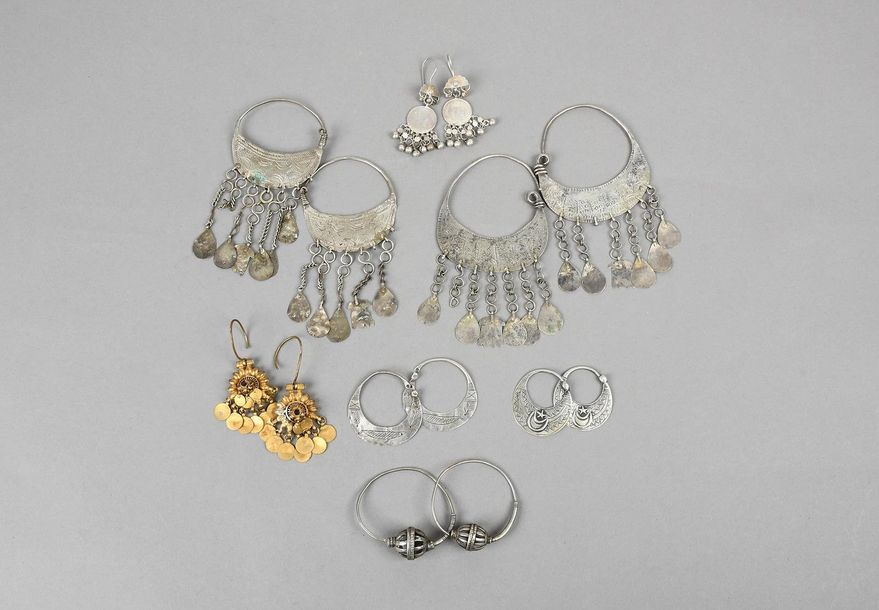 Seven pairs of Nubian earrings silver coloured metal, four of crescent form with…