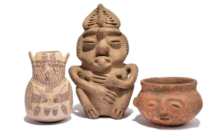 A Nazca effigy vessel Peru pottery, with polychrome decoration of a shaman holdi…