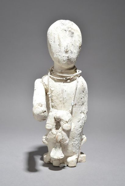 A Ewe power figure Ghana the seated figure with an outstretched right arm and we…