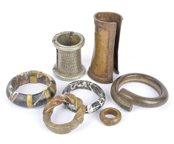 Two Mali / Burkina Faso bangles black and white veined stone, one with brass rep…