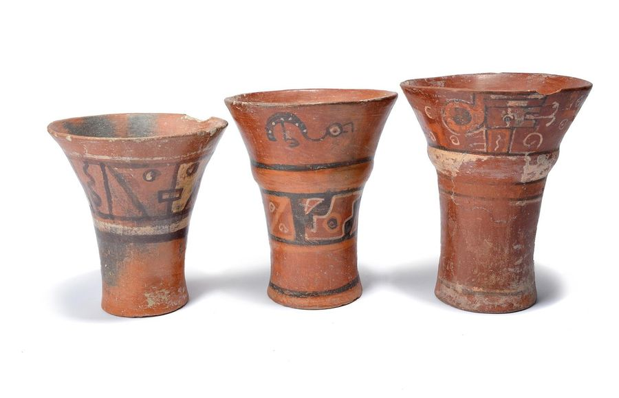 Three Tiwanaku keros Bolivia terracotta, two with convex bands, painted birds, g…